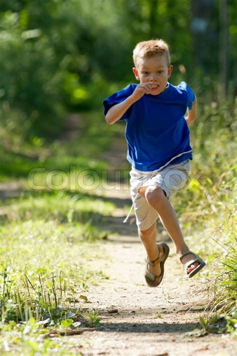 Young boy running in nature | Stock Photo | Colourbox